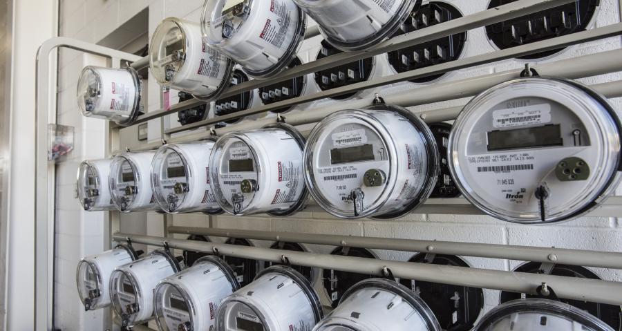 Electric Meters hanging on a meter rack